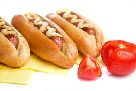 Three hot dogs with tomato