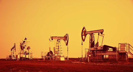 Oil pump jack.Orange filtered image.