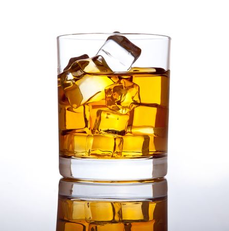 Glass of scotch whiskey and ice. photo