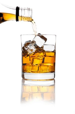 whiskey and ice on white