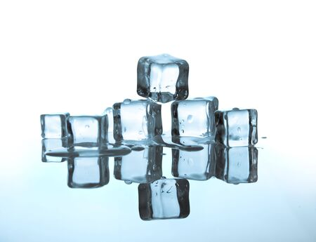 icecube: melting ice cubes on glass table.