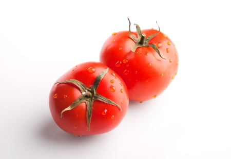 Two tomatoes on white