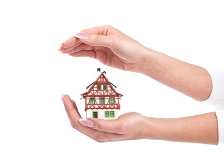 woman hands protect little house Stock Photo - 8628873