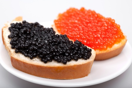 two sandwiches with red and black caviar on plate Stock Photo - 11976408
