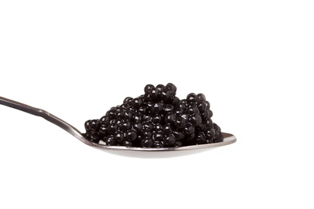 black caviar in spoon on white background Stock Photo