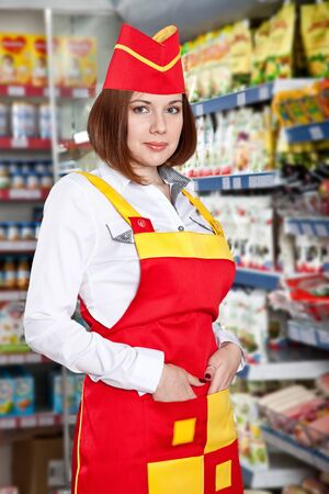 the woman seller in food supermarket.