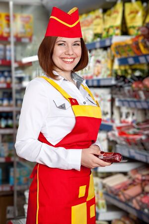 the woman seller in food supermarket. Stock Photo - 13698257