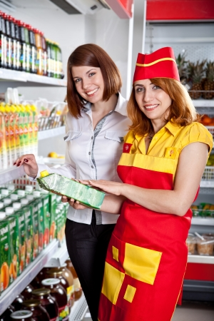 seller: The seller and the buyer in grocery shop Stock Photo