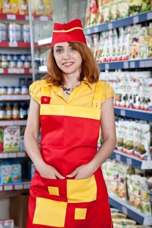 the woman seller in food supermarket Standard-Bild