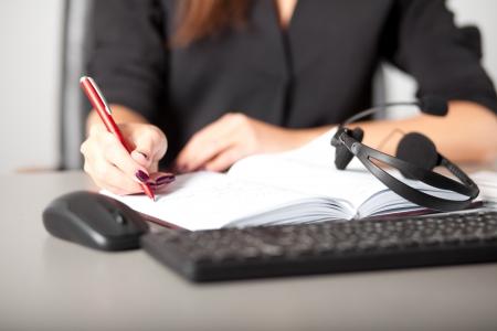 Helpline operator writing notes