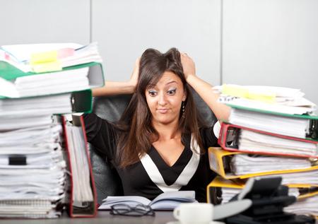 Stress on work woman holding her head Standard-Bild