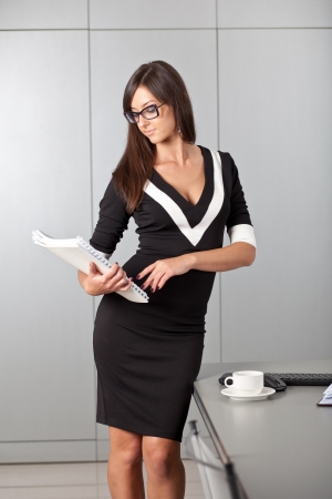 Pretty woman working in office Stock Photo