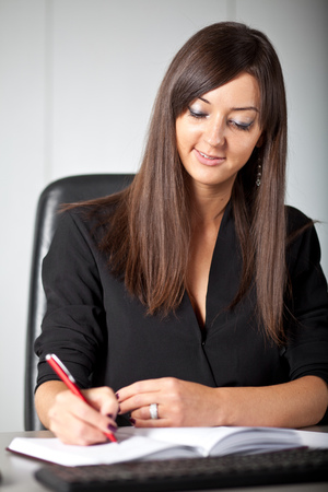 Woman writing on work place