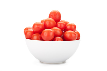 Cherry tomatoes on white plate, on white background