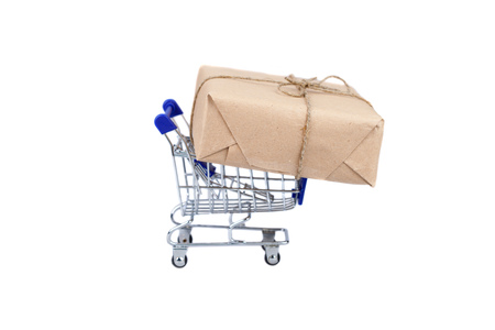 Shopping cart with box on white isolated background