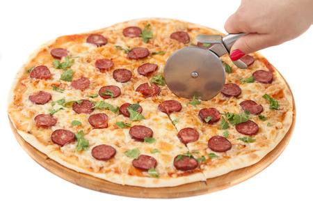 pizza cutting isolated on white