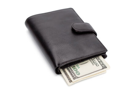 overfilled: black leather wallet isolated on white