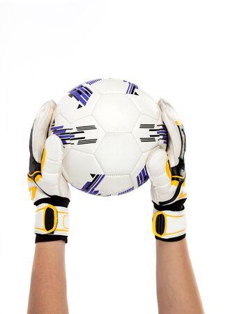 portero de futbol: portero de f�tbol con la pelota en la mano Foto de archivo