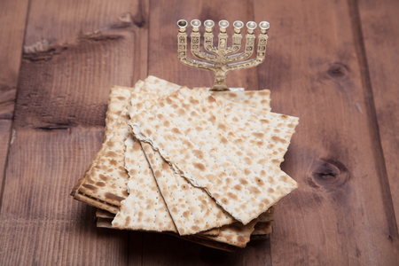 Jewish matza with menorah on table