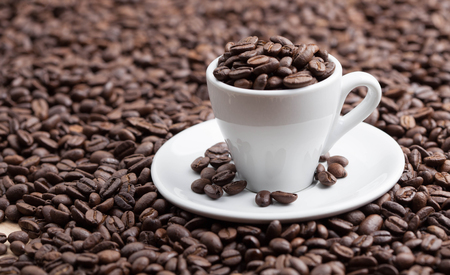Ceramic cup full roasted coffee breans Stock Photo