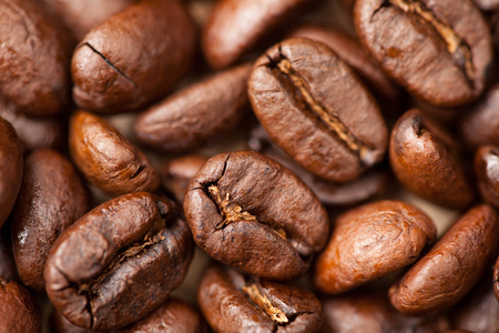 Brown Coffee beans macro as a background