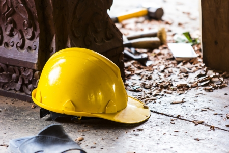 Hard hat on the construction site on the background.