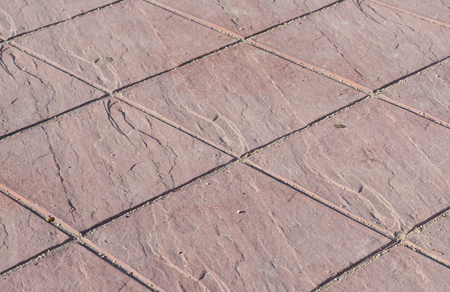 Stamped concrete floor outdoor pavement red square pattern detail Stock Photo