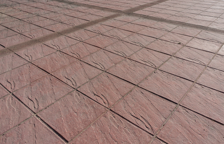 concrete surface finishing: Stamped concrete floor outdoor pavement red square pattern with dilatation joint