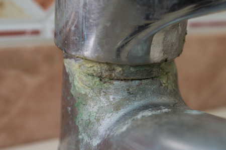 calcification: Water tap in detail with limescale close up soiled bathroom Calcified faucet