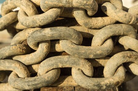 catena: group of old rusty chain link detail macro