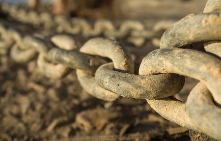 catena: Close-up of links of a long iron chain in detail