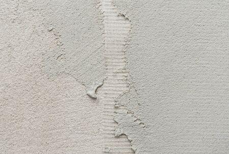 fibra de vidrio: de malla de cerca de microcemento gruesa capa de preparación en la pared que cubre la fibra de vidrio de la pizca de revestimiento microtopping Foto de archivo