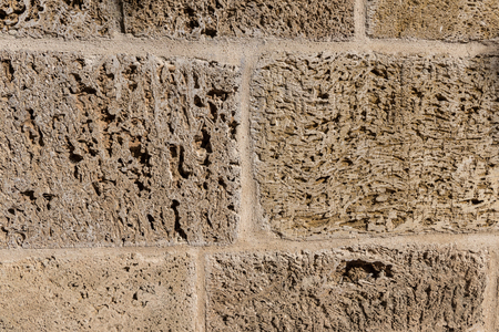outworn: detail of wallcovering with grunge stone texture wall Stock Photo