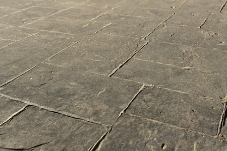 Gray stamped concrete slate seamless texture pattern, pavement outdoor, decorative appearance colors and textures of paving slate stone tile on cement patio design, perspective Banco de Imagens