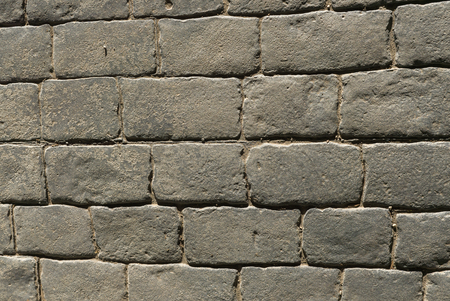 Stamped concrete pavement outdoor, mimics cobblestones pattern, flooring exterior, decorative appearance colors and textures of paving cobble stone, top view