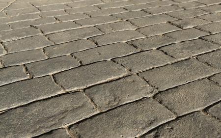 Stamped concrete pavement outdoor, mimics cobblestones pattern, flooring exterior, decorative appearance colors and textures of paving cobble stone perspective Standard-Bild
