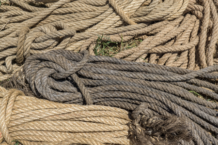 intertwined: rope pattern formed by different colors of worn intertwined strings