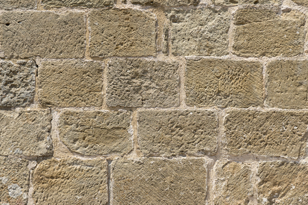 mottling: Wall built with blocks of hand carved stone, subsequently restored, Romanesque XI century, XII
