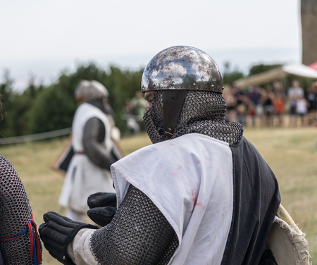 a war historian: Loarre, Spain - July 09, 2016: Medieval reenactment with costumed characters and medieval armor with chainmail, helmet swords and shields. Editorial