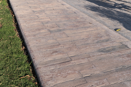 stamped concrete pavement outdoor, Wooden slats pattern, flooring exterior, join of two different patterns, decorative texture of cement paving Appearing the streaks of wood