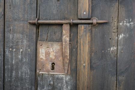 Closeup vintage door lock of external antique wooden door with a door pin  lock, weathered - Closeup Vintage Door Lock Of External Antique Wooden Door With