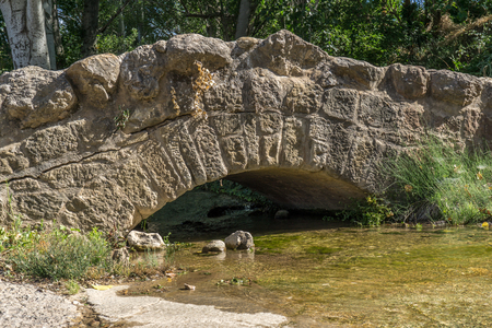 Small Medieval stone bridge on a stream in Loarre Spain