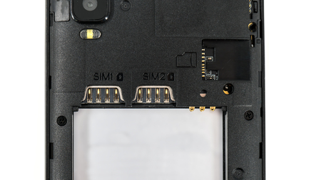 Slot for dual SIM cards and sd card, on a cell phone, mobile phone, smartphone close-up macro detail, isolated over white background