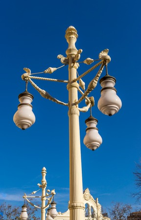 vintage old street lamp old fashioned victorian style lampost against a blue sky