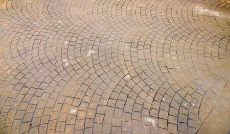 waterproof Stamped concrete pavement outdoor, mimics cobblestones pattern, wet flooring exterior, decorative appearance colors and textures of paving cobble stone Banco de Imagens