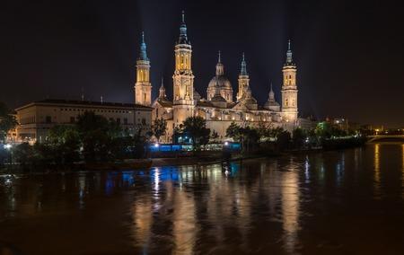 Basilica Cathedral Pilar Zaragoza Aragon Spain night illumination, water reflection Ebro river
