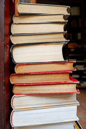 Very old books, vintage literature composition, stacked one on top of the other, in balance