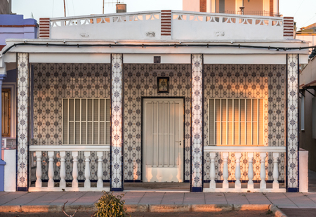 typical mediterranean house Spain coast town, facade of single-story dwelling