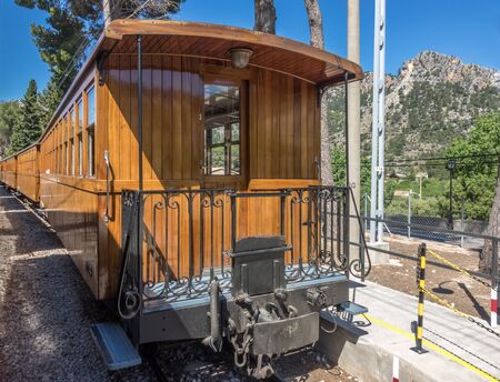 Historic wooden train Tram between Soller and Palma with views over the Soller village and mountains range Serra de Tramuntana, Mallorca Balearic Islands