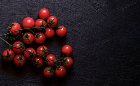 Fresh cherry tomatoes isolated on a black background. Top view with copy space Zdjęcie Seryjne